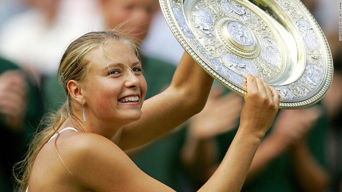 Sharapova holds up her trophy after she won Wimbledon in July 2004. The 17-year-old defeated Serena Williams in the final for her first Grand Slam title.