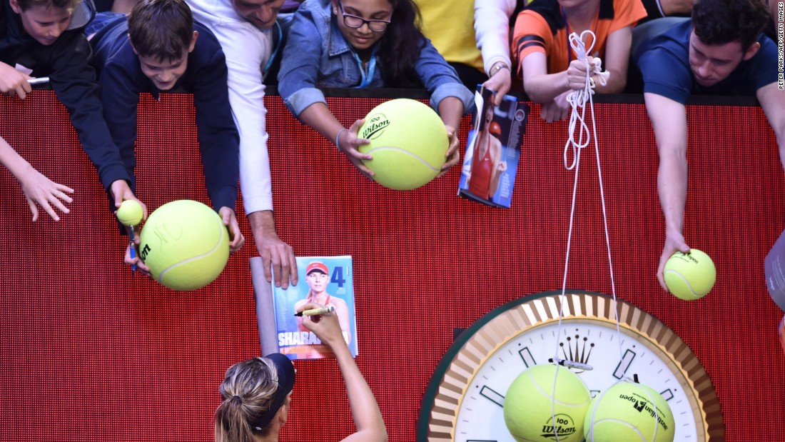 Sharapova signs autographs after winning a match at this year's Australian Open in January. She later announced she had tested positive for banned drug meldonium and was banned for two years by the International Tennis Federation.