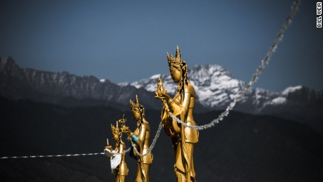 Perched above the capital, gold painted Dakinis - the angels of the Buddhist world - look over the valley below.