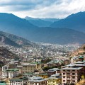 With a population of just under 100,000, the quickly growing capital of Thimphu sits nestled in a narrow Bhutanese valley. Bhutan is half the size of Indiana, and two thirds of it is covered by pristine forest. Their constitution insists, it must stay that way - forever.