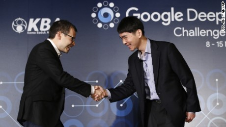 CEO of Google DeepMind, Demis Hassabis, left, shakes hands with South Korean professional Go player Lee Sedol during a press conference  on March 8 ahead of the Google DeepMind Challenge Match in Seoul. Lee Sedol and Google's artificial intelligence program, AlphaGo will play in a five game tournament from March 9 to March 15.