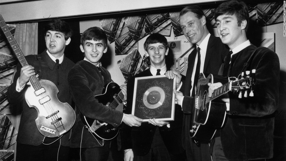 "<a href=""http://www.cnn.com/2016/03/09/entertainment/george-martin-obit/index.html"">Sir George Martin</a>, the music producer whose collaboration with the Beatles helped redraw the boundaries of popular music, died March 8, according to his management company. He was 90. Above, Martin poses with the Beatles after the album ""Please Please Me"" went silver in 1963."