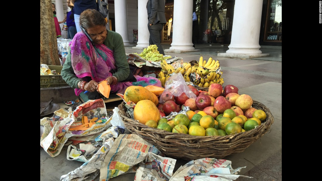 "INDIA: ""An elderly street vendor in New Delhi is seen talking on a smartphone. Home to a population of almost 1.3 billion people, India is already the world¹s third largest market for smartphones."" - CNN's Harmeet Singh <a href=""http://instagram.com/harmeetshahsingh"" target=""_blank"">@harmeetshahsingh</a>."
