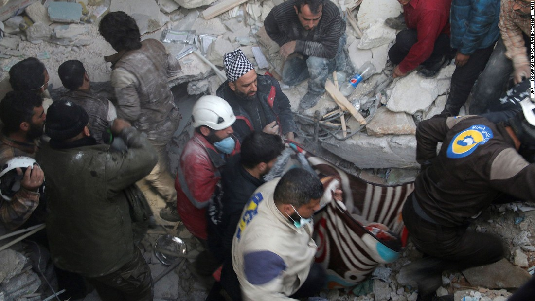 Rescue workers pull victims from an Idlib hospital hit by an airstrike in February.