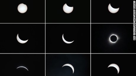 This photo combo shows the moon passing in front of the sun (top L to bottom R) during a total solar eclipse in the city of Ternate, in Indonesia's Maluku Islands, on March 9, 2016.  A total solar eclipse swept across the vast Indonesian archipelago on March 9, witnessed by tens of thousands of sky gazers and marked by parties, Muslim prayers and tribal rituals. / AFP / BAY ISMOYO        (Photo credit should read BAY ISMOYO/AFP/Getty Images)