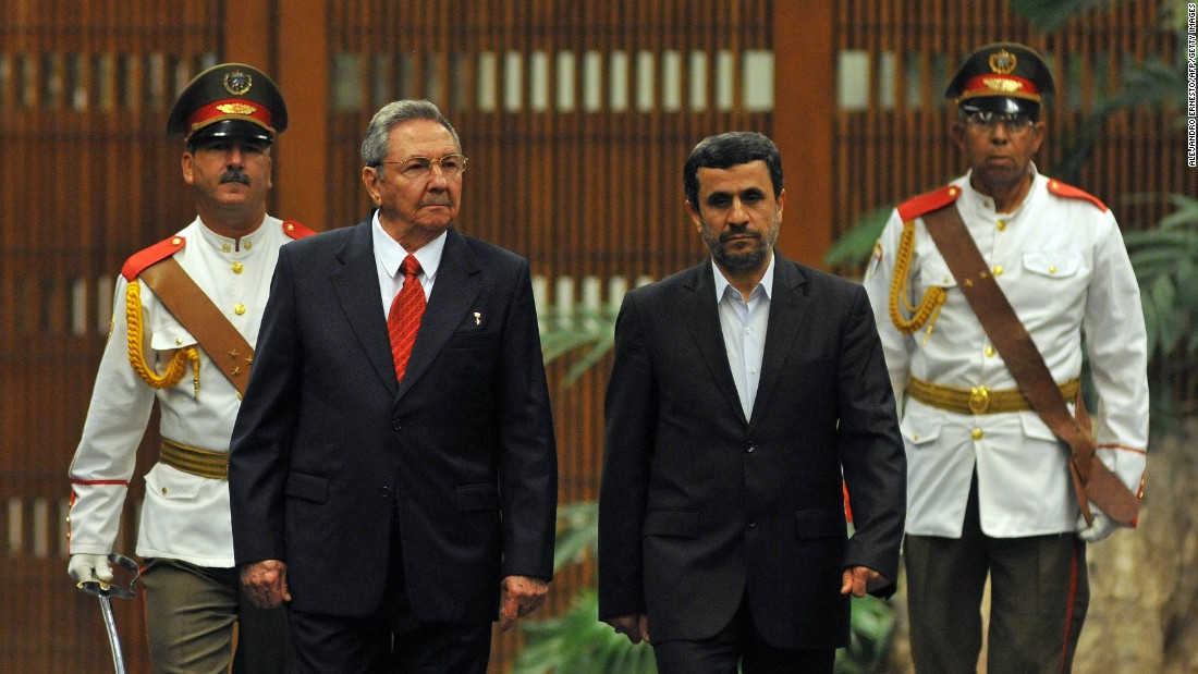 "Cuba has hosted multiple visits by Iranian heads of state. Here, Cuban President Raul Castro, left, attends a welcoming ceremony with Iranian President Mahmoud Ahmadinejad in 2012. During his trip, Ahmadinejad called on developing countries to unite against ""imperialism and capitalism."""