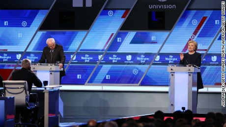 MIAMI, FL - MARCH 09:  Democratic presidential candidate Senator Bernie Sanders (D-VT) and Democratic presidential candidate Hillary Clinton debate during the Univision News and Washington Post Democratic Presidential Primary Debate at the Miami Dade College's Kendall Campus on March 9, 2016 in Miami, Florida. Voters in Florida will go to the polls March 15th for the state's primary.  (Photo by Joe Raedle/Getty Images)