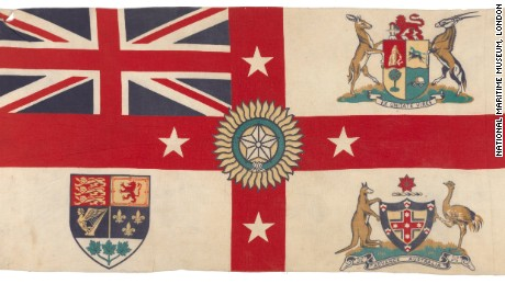 Date made: after 1921. A version of the White Ensign with the arms of South Africa, Australia, and Canada in the quarters and the Star of India in the centre. New Zealand is represented by four white stars on the red cross. The motto of Australia is 'ADVANCE AUSTRALIA' and of South Africa 'EX UNITATE VIRES'. The flag is made of cotton, the edges machine sewn with the design printed onto the fabric. It does not have a hoist. The flag dates from after 1921 when the arms of Canada were changed. This seems to be an unofficial design first produced in about 1911 and subsequently updated.