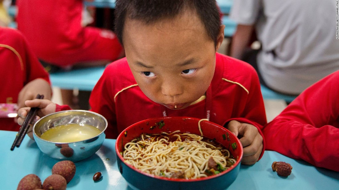 A young player eats in the school's canteen. Special chefs have been flown in from the northwestern Xinjiang province to cater for the dietary requirements of the region's Muslim players.