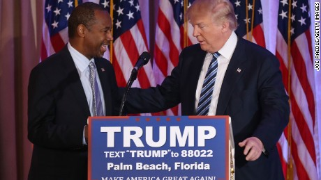 Republican presidential candidate Donald Trump stands with former presidential candidate Ben Carson as he receives his endorsement at the Mar-A-Lago Club on March 11, 2016 in Palm Beach, Florida. Presidential candidates continue to campaign before Florida's March 15th primary day.  (Photo by Joe Raedle/Getty Images)