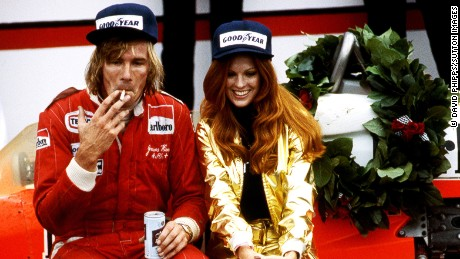 James Hunt (GBR) celebrates his win in Victory Lane with his McLaren M26, a cigarette, a beer, and a Penthouse Pet. Formula One Championship, Rd 15, United States Grand Prix East, Watkins Glen, USA, 2 October 1977. BEST IMAGE