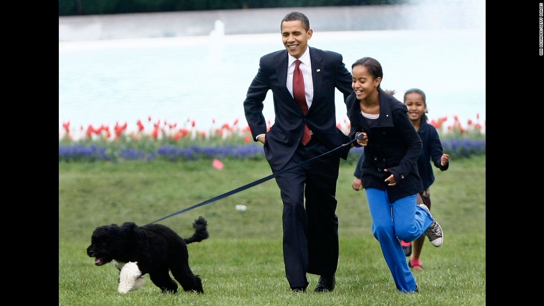 President Obama with his daughters and new dog Bo, during the dog's introduction to the White House press corps on the South Lawn of the White House on April 14, 2009. The 6-month-old puppy was a gift from the late Sen. Edward M. Kennedy.