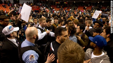 Anti-Donald Trump protesters confront with his supporters during a Trump rally at the UIC Pavilion in Chicago on March 11, 2016.