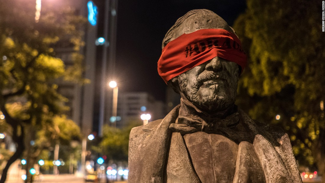 An anonymous artist in Brazil has blindfolded statues across the city of Rio de Janeiro in an effort to silently and peacefully protest the country's growing corruption problem.