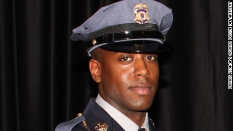 Slain officer 'heroically' diverted gunfire
