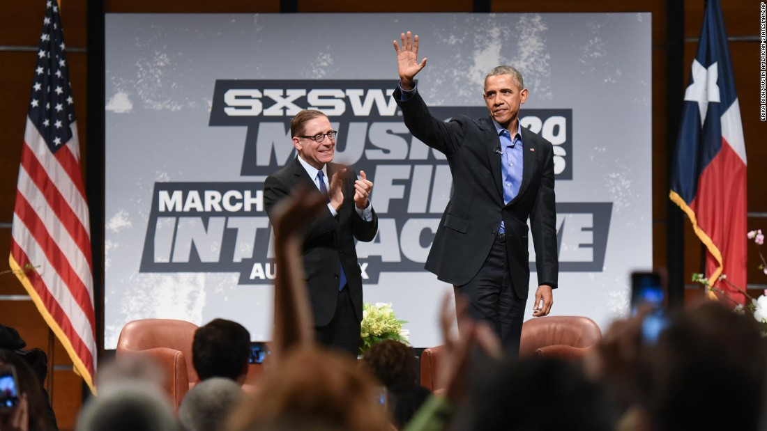 "President Barack Obama waves onstage with Texas Tribune editor-in-chief Evan Smith during a keynote session at the <a href=""http://money.cnn.com/2016/03/11/technology/obama-keynote-sxsw-2016/"" target=""_blank"">2016 South by Southwest festival</a> in Austin, Texas, on Friday, March 11."