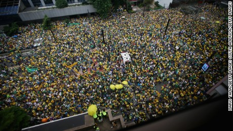 Anti-government protestors flood Sao Paulo's streets Sunday.