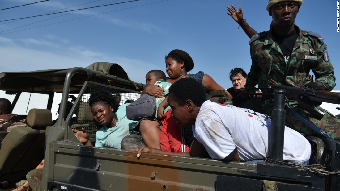 Ivorian forces transport civilians to safety.