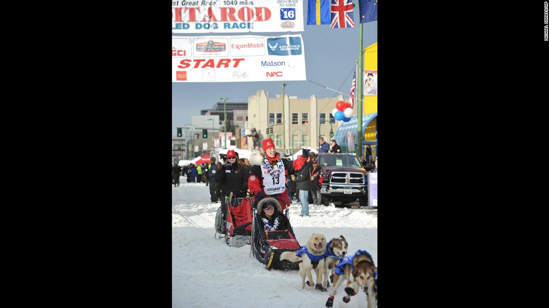Race veteran Aliy Zirkle waves at the ceremonial start in Anchorage, Alaska.