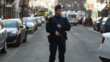 Gunfire at raid tied to Paris attacks