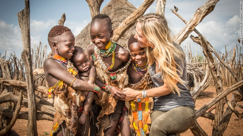 """""""The children are always the easiest to photograph as they love to touch, laugh and joke with me, says Seton. """"These children were fascinated with my long blond hair and loved to touch it."""""""