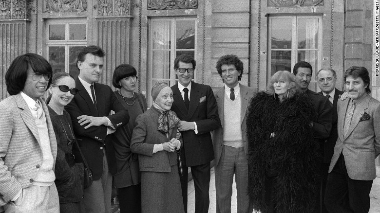 Sonia Rykiel (in black feathers) poses with the French Minister of Culture Jack Lang (7th L) and her fashion contemporaries fashion in Paris in 1984.
