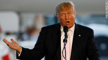 """FILE - In this Monday, March 14, 2016 file photo, Republican presidential candidate, Donald Trump holds a plane-side rally in a hanger at Youngstown-Warren Regional Airport in Vienna, Ohio. Fear of a changing America is fueling some of the anger playing out publicly around Trump's bid for the GOP presidential nomination, historians Ken Burns and Henry Louis Gates Jr. said Monday. Trump is """"speaking to a need and a deep set of fears within a large segment of the American community,"""" added Gates, a Harvard University scholar and host of a genealogy show on PBS. """"Those fears need to be assuaged, and policies formulated to meet the needs of those worried about their future,"""" he said. (AP Photo/Gene J. Puskar, File)"""