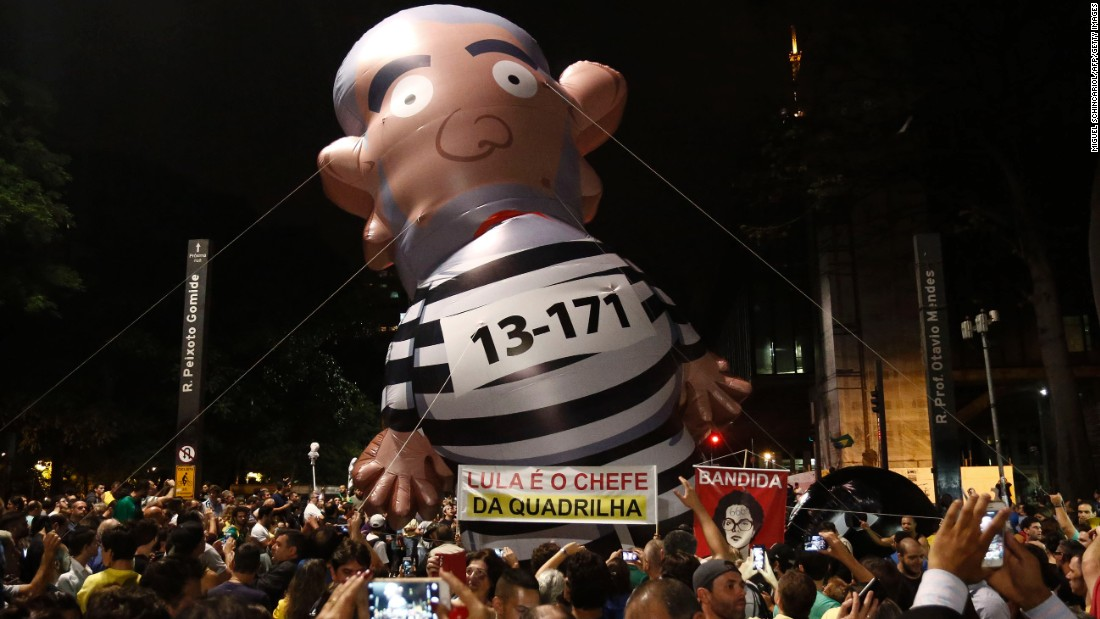 Demonstrators in Sao Paul carry a balloon depicting Lula da Silva as a convict on March 16.