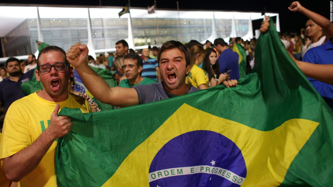 Demonstrators call for Rousseff's resignation outside the presidential palace in Brasilia on Wednesday, March 16.