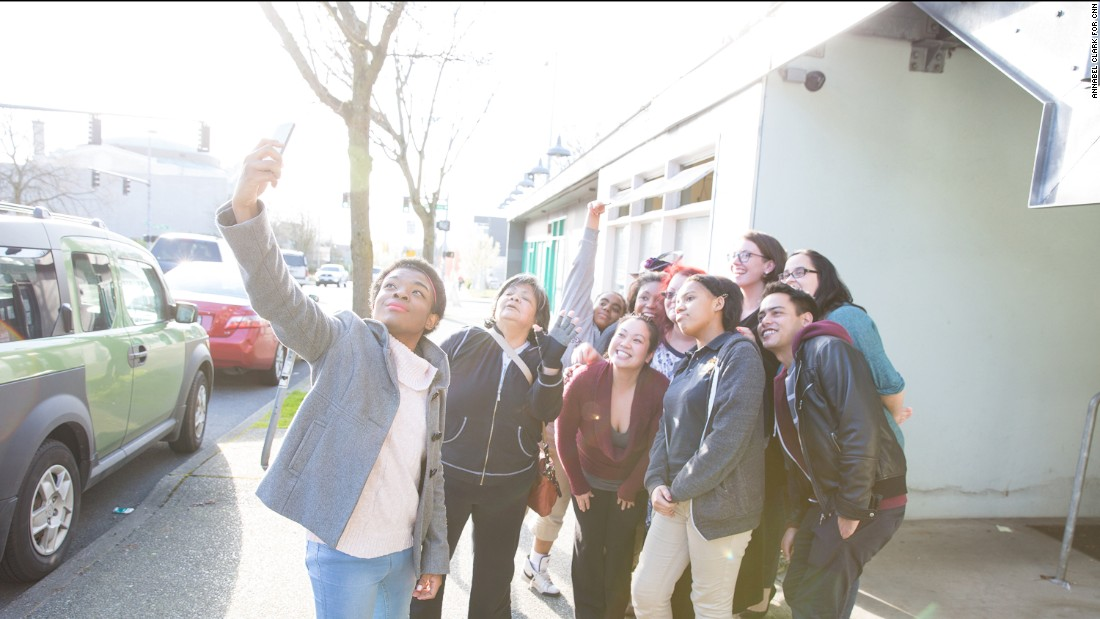 Marcelas takes a selfie with members of Washington CAN! Marcelas' work with the network led to a White House invitation and a fist-bump from Obama.<br />