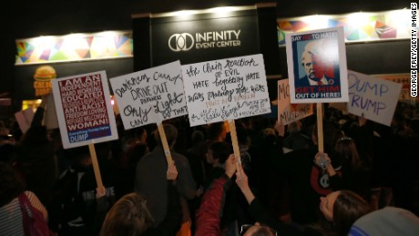 Protesters gather outside the Infinity Event Center where Republican presidential candidate Donald Trump was to speak at a campaign rally in Salt Lake City, Utah.