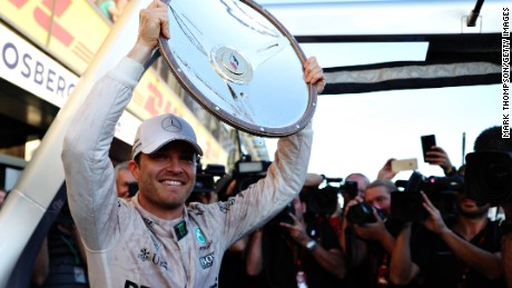 Nico Rosberg holds the winning trophy aloft after his triumph at the Australian Grand Prix in Melbourne.