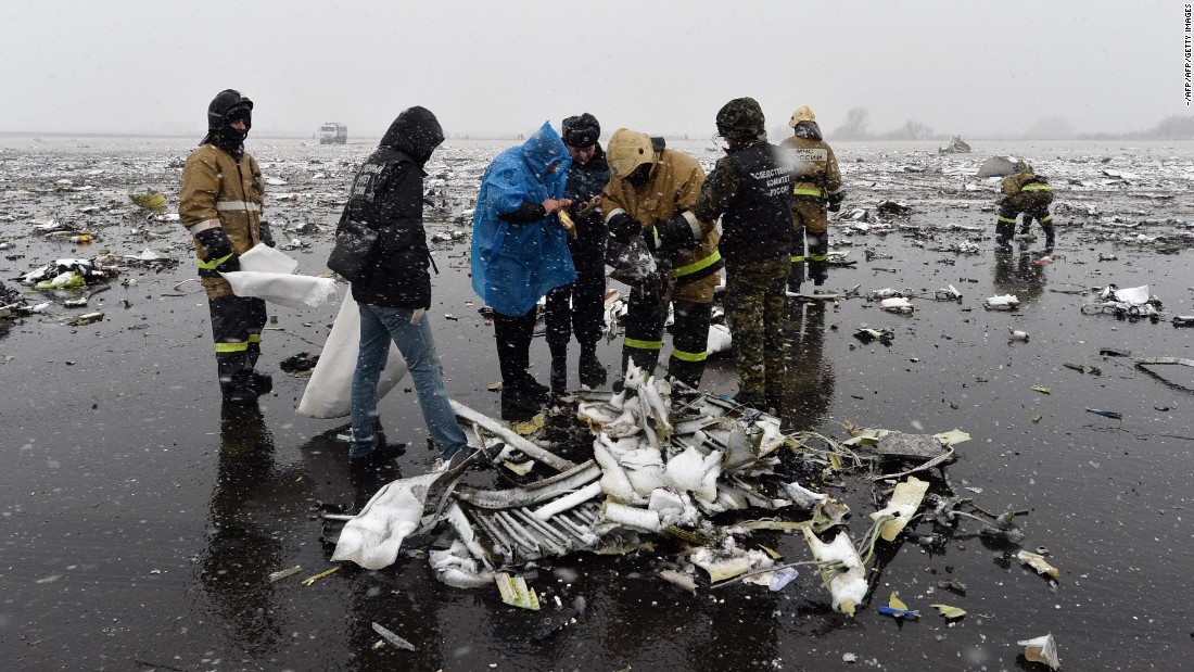 "Russian emergency rescuers and forensic investigators work on the wreckage of the <a href=""http://edition.cnn.com/2016/03/18/europe/russia-plane-crash/"">flydubai passenger jet that crashed</a>, killing all 62 people on board as it tried to land in bad weather in the Russian city of Rostov-on-Don on March 19."
