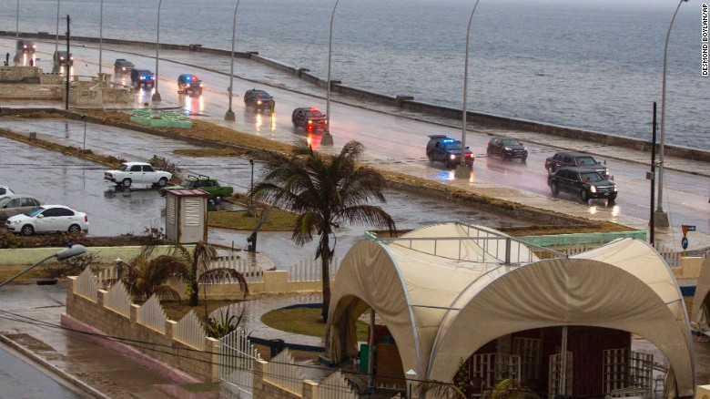 Obama's convoy drives along the Malecon sea wall on March 20.