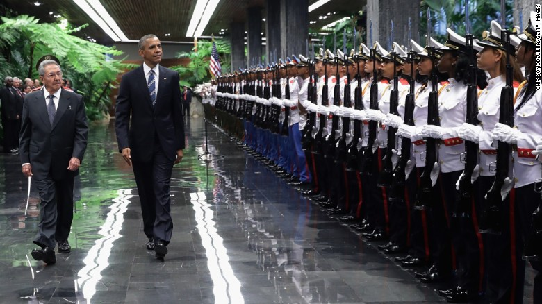 Obama and Castro review troops before bilateral meetings on March 21.