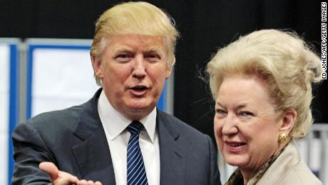 US property tycoon Donald Trump (L) is pictured with his sister Maryanne Trump Barry as they adjourn for lunch during a public inquiry over his plans to build a golf resort near Aberdeen, at the Aberdeen Exhibition & Conference centre, Scotland, on June 10, 2008. Trump wants to build a giant complex on the Scottish east coast near Aberdeen, but has run into opposition from environmentalists and a local farmer who refuses to budge. The Scottish government has called for a full public inquiry into the plans. AFP PHOTO/Ed Jones (Photo credit should read ED Jones/AFP/Getty Images)