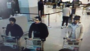Police say they are looking for the man on the right in connection with the Brussels attack.
