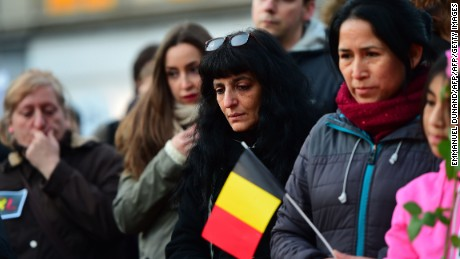 People gather to pay a tribute to victims of terrorist attacks in Brussels on March 22, 2016 at a makeshift memorial. Around 35 people were killed and more than 200 wounded in a series of attacks in Brussels today claimed by the Islamic State group and described as a strike at the very heart of Europe.