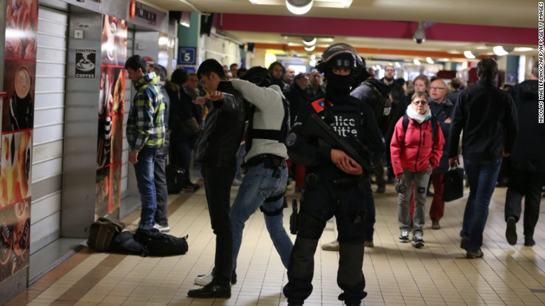 Police forces make searches inside the North station (Gare du Nord - Noordstation) on March 22, 2016 in Brussels, as stations are opened again with high security measures  after a series of apparently coordinated explosions that ripped through Brussels airport and the metro train, killing at least 14 people in the airport and 20 people in the metro in the latest attacks to target Europe.  Belgian police issued a wanted notice for a suspect in the bomb attack on Brussels airport on March 22 in which at least 14 people were killed. The Islamic State group  officially claimed responsibility for the attacks in Brussels that left some 35 people dead and threatened further violence.   / AFP / Belga / NICOLAS MAETERLINCK / Belgium OUT        (Photo credit should read NICOLAS MAETERLINCK/AFP/Getty Images)