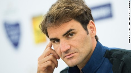 Roger Federer of Switzerland gestures during a press conference ahead of the Shanghai Masters tennis tournament in Shanghai on October 11, 2015. The tournament will take place from October 12 to 18.    AFP PHOTO / JOHANNES EISELE        (Photo credit should read JOHANNES EISELE/AFP/Getty Images)
