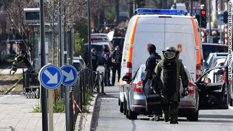 A member of a bomb squad arrive to take part in an anti-terrorist operation on tramway tracks in the Schaerbeek - Schaarbeel district in Brussels on March 25, 2016. Belgian police carrying out a fresh anti-terrorist operation today arrested a suspect, who suffered a slight injury, Schaerbeek Mayor Bernard Clerfayt told AFP. Police sources said the operation was connected to a foiled terror plot in France.  / AFP / PATRIK STOLLARZ        (Photo credit should read PATRIK STOLLARZ/AFP/Getty Images)