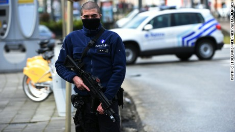 A police officer patrols near a tramway train after it was evacuated during an anti-terrorist operation in the Schaerbeek - Schaarbeel district in Brussels on March 25, 2016. Belgian police carrying out a fresh anti-terrorist operation today arrested a suspect, who suffered a slight injury, Schaerbeek Mayor Bernard Clerfayt told AFP. Police sources said the operation was connected to a foiled terror plot in France.  / AFP / PATRIK STOLLARZ        (Photo credit should read PATRIK STOLLARZ/AFP/Getty Images)
