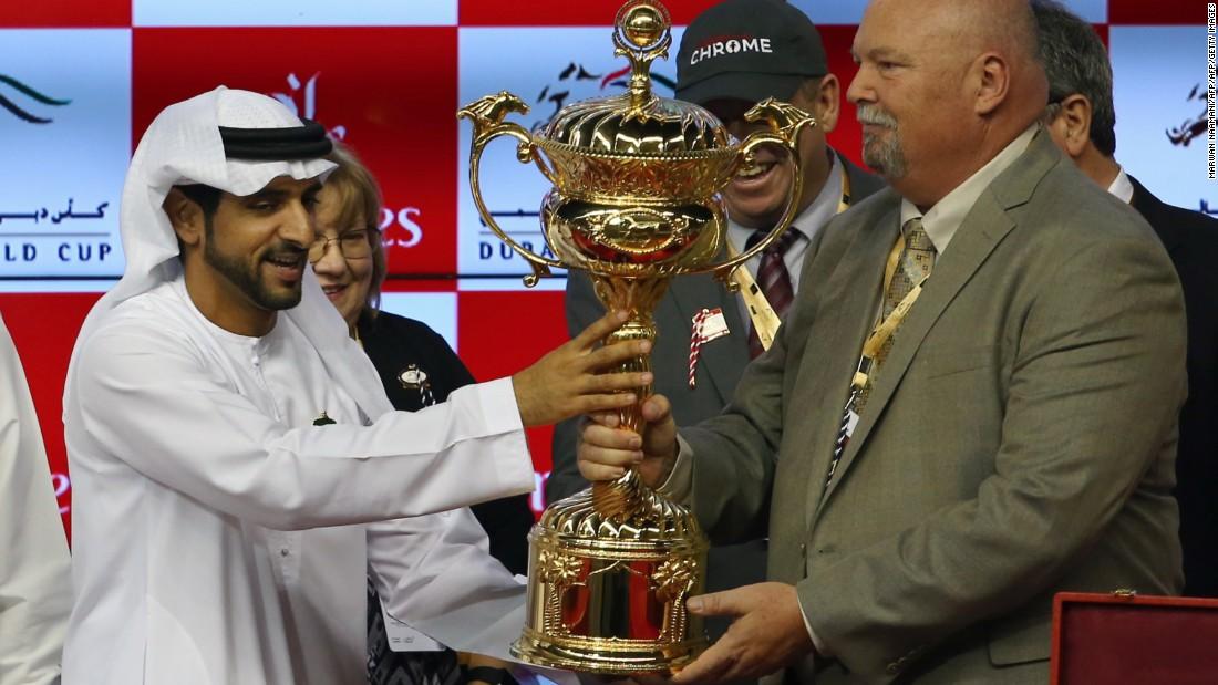 Sheikh Hamdan Bin Mohammad Bin Rashid al-Maktoum,  crown prince of Dubai, presents the owners of U.S. horse California Chrome with the Dubai World Cup trophy. Sheikh Hamdan is the owner of Mohaymen, one of the favorites in Kentucky.