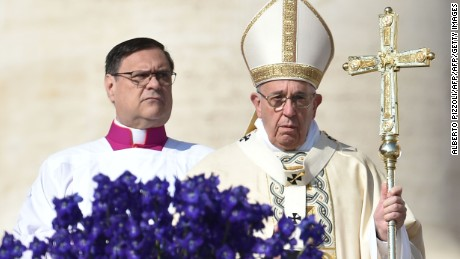 Pope Francis (R) leads the Easter Sunday mass on March 27, 2016 at St Peter's square in Vatican. Christians around the world are marking the Holy Week, commemorating the crucifixion of Jesus Christ, leading up to his resurrection on Easter.     AFP PHOTO / ALBERTO PIZZOLI / AFP / ALBERTO PIZZOLI        (Photo credit should read ALBERTO PIZZOLI/AFP/Getty Images)