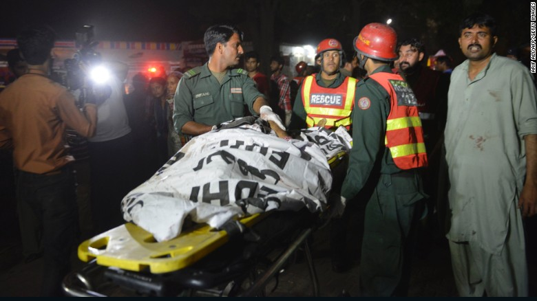Pakistani rescuers use a stretcher to shift a body from a bomb blast site in Lahore on March 27, 2016. At least 25 people were killed and dozens injured when an explosion ripped through the parking lot of a crowded park where many minority Christians had gone to celebrate Easter Sunday in the Pakistani city Lahore, officials said. / AFP / ARIF ALI (Photo credit should read ARIF ALI/AFP/Getty Images)
