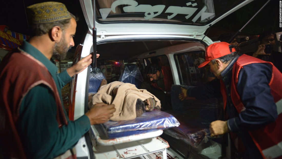 A victim is loaded into an ambulance near the site of the blast.