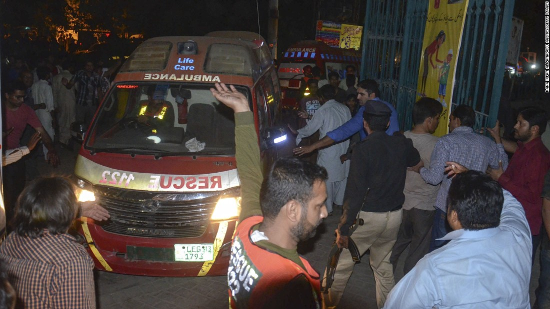 Rescue workers and police gather near the site of the blast.