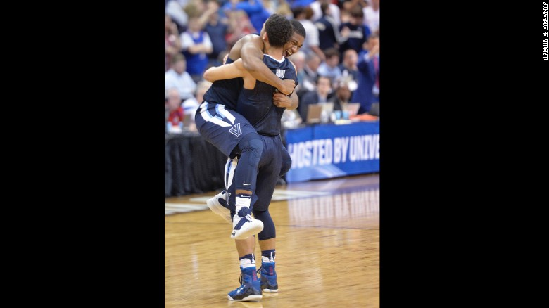 Villanova forward Kris Jenkins celebrates with teammate Josh Hart after defeating Kansas in the South Regional Final of the NCAA tournament on Saturday.