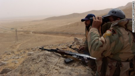 Syrian troops monitor the surrounding area from their location on the outskirts of Palmyra on March 24.