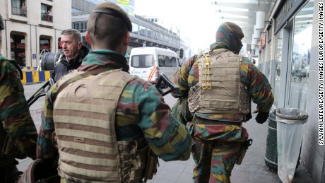 BRUSSELS, BRUXELLES-CAPITALE, REGION DE - MARCH 27: Soldiers patrol the area after a peaceful gathering was disrupted by right-wing demonstrators on March 27, 2016 in Brussels, Belgium. The demonstration in the Place de la Bourse is believed to be in reaction to last week's terrorist attacks in Brussels and was later dispersed by riot police using water cannons. (Photo by Sylvain Lefevre/Getty Images)